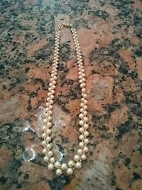 white and black beaded necklace 48 km