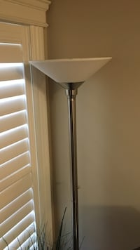 white and gray stainless steel torchiere lamp