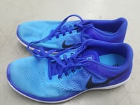 pair of blue Nike running shoes Falls Church, 22046