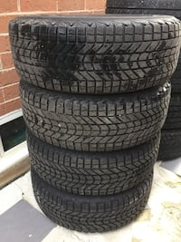 Four black vehicle tires with wheels Vaughan, L4H 2G9