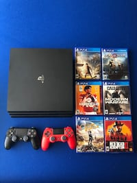 PS4 Pro 1 TB Bundle w/ 2 Controllers + 6 games!