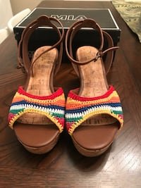 Pair of brown-and-red sandals Greensboro, 27406