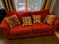 red fabric 2-seat sofa with throw pillows Toronto, M5V 3K2