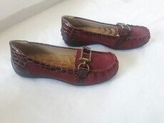 Women's pair of maroon loafers size 7