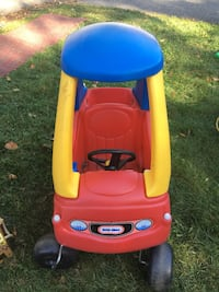 and yellow Little Tikes cozy coupe
