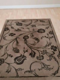 Brown and black floral area rug New Westminster