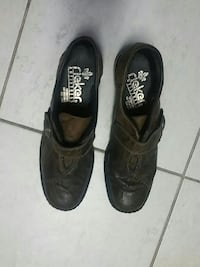 women's pair of black leather loafers