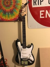 Stratocaster-style white and black electric guitar