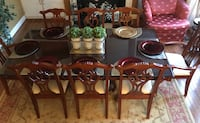 Dining room set with 8 chairs. Table has custom-made glass cover.  Woodbridge, 22192