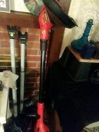 Black and Decker cordless trimmer weed eater.