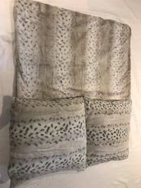 Leopard print throw and two pillows