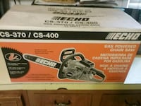 Black and orange 18 in bar chainsaw brand new  box