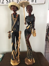 two Man and Woman wooden figurines
