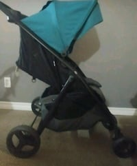 Baby's black and blue stroller 549 km