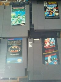 four NES game cartridges
