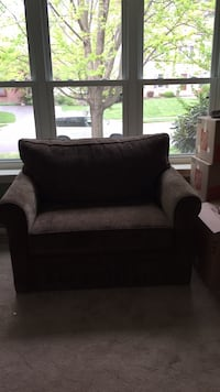 Brown fabric over-sized chair