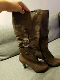 pair of brown leather knee-high boots Calgary, T3M 2C6