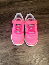 pink-and-white Nike running shoes Boca Raton, 33434