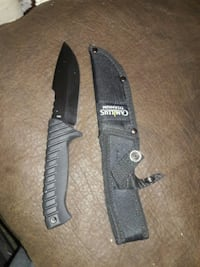 black and gray Camillus combat knife with sheath Hanover, 17331
