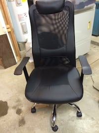 black leather padded rolling armchair 406 mi