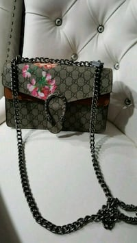 gray Gucci leather crossbody bag
