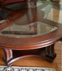 Round Mohagany w/glass top coffee table Aurora, L4G 7N7