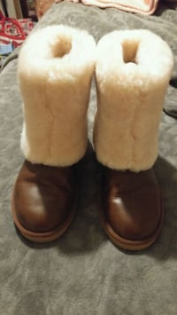 pair of brown leather boots UGGS