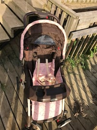Pink and brown stroller  495 km