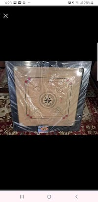 Carrom board with coins