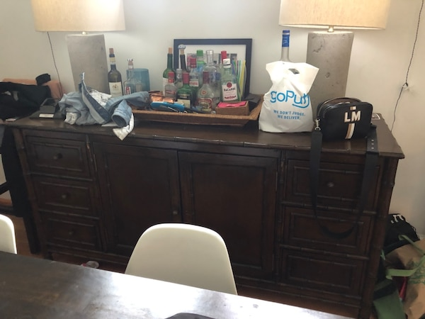 Dark brown wood breakfast buffet. Works well as bar. Tons of storage.
