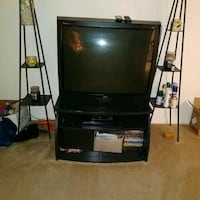 black flat screen TV and black TV stand 49 km