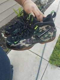 pair of black-brown-and-green camouflage Nike basketball shoes