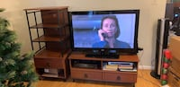 Brown wooden tv stand and flat screen tv Silver Spring, 20906