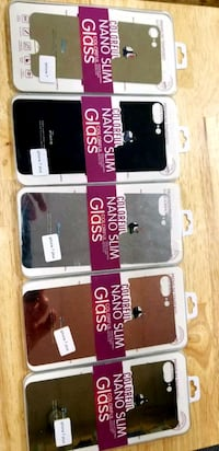 three assorted iPhone cases with packs Houston, 77045