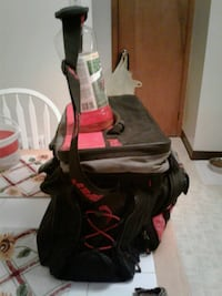 Black and red, tackle bag whit 5 departments and a Hagerstown, 21740