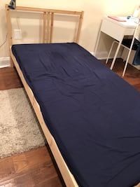 black wooden bed frame with blue mattress Washington, 20009