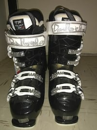 pair of black-and-white ice skates shoes