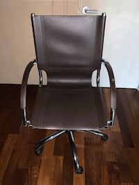 Black leather rolling desk chair from West Elm furniture Fort Lauderdale, 33301
