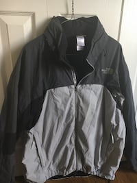 North Face Jacket. Men's XL Two front pockets. Velcro was adjustable sleeves. Aerated arms. Hidden Hood. Great jacket Cochrane, T4C 1K6