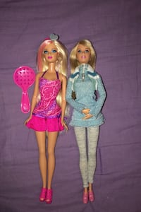 Pink and blue Barbie dolls