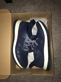 pair of dark blue  Adidas running shoes in box