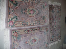 three floral area rug's