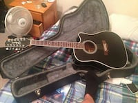 black acoustic guitar with case Coquitlam, V3B 2T5