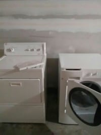 two white front-load clothes dryers 73 mi