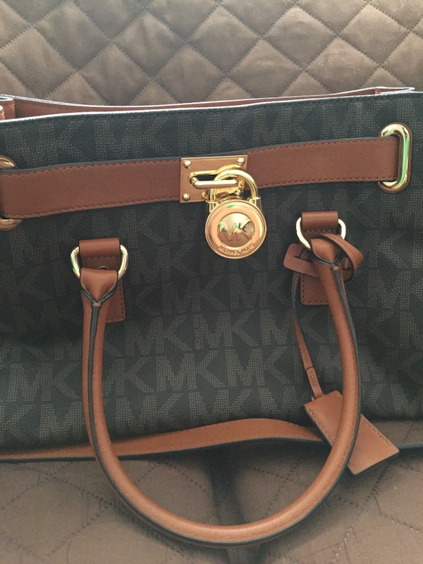 437f9e67d19f87 Used Black and brown michael kors leather tote bag for sale in ...