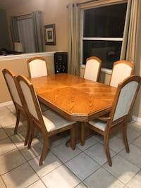 Rectangular brown wooden table with four chairs dining set Palmetto