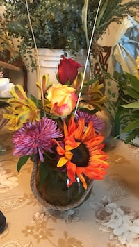 two purple, one red, and two yellow petaled flowers