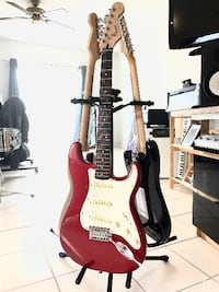 Red and white stratocaster by Fender electric guitar Tamarac