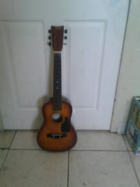 brown and black classical guitar Orlando, 32811