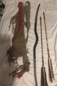 Antique bow and Quiver with reproduction arrows.